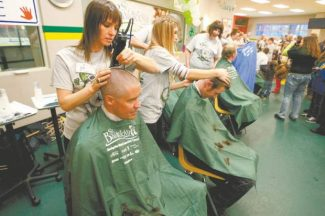 On Saturday, participants in the St. Baldrick's event at the South Lake Tahoe Ice Arena will have their heads shaved to raise money for childhood cancer research, as shown in this photo.