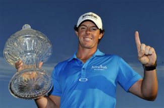 Rory McIlroy holds the trophy after winning the Honda Classic golf tournament in Palm Beach Gardens, Fla., Sunday, March 4, 2012. McIlroy became the top-ranked golfer in the world. (AP Photo/Rainier Ehrhardt)