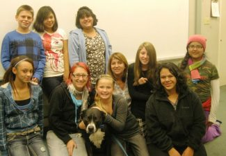 """ProvidedMembers of the Boys & Girls Builders Club recently raised funds for """"BADRAP,"""" a pit bull education and rescue group. Builders Club members include, front row, left to right: Mercadies Gentry, Nina Aegerter, Jade Burghard, Blaze, Sandy Pape, Aria D'Aintree, Lindsey Torres, Nellie Cuellar; standing: Konaugher Bannister, Abcde Giesseman, and Selina Perez."""