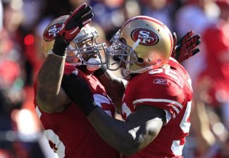 FILE - In this Aug. 27, 2011, file photo, San Francisco 49ers linebacker Ahmad Brooks, left, celebrates after scoring on a touchdown on an interception of Houston Texans quarterback Matt Schaub with linebacker Patrick Willis in the first quarter of a preseason NFL football game in San Francisco. Brooks signed a six-year contract extension with the 49ers on Tuesday, Feb. 28, 2012, that will take him through the 2017 season and keep one of the NFL's best linebacker corps intact. (AP Photo/Marcio Jose Sanchez, file)