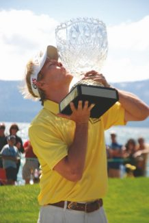 Published Caption: RIGHT: Jack Wagner kisses the American Century Cup after winning the July golf tournament. This yearÕs event was the biggest in its 22-year history, attracting more than 40,000 spectators and contributing more than $10 million to the local economy.