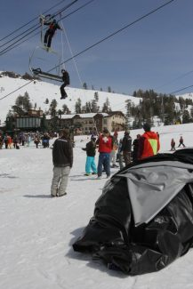 Adam Jensen / Tahoe Daily TribuneSki patrol lowers a woman from Kirkwood Mountain Resort's Chair 6 Saturday afternoon after a gust of wind blew the resort's airbag into the lift, derailing it. The airbag can be seen in the foreground.