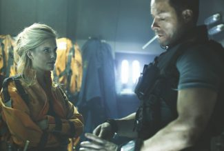 "Maggie Grace and Guy Pearce star in the outer-space adventure ""Lockout."""