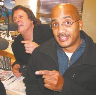 Dexterous attitudinizing is a characteristic show businessmen must possess. Howie Nave, left, and John Henton display synchronized affectation in this image intended to publicize their collective standup comedy appearance at the Improv in Harveys Resort and Casino.