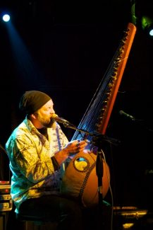 Photo by Nick BrownPeter Joseph Burtt sings and plays the West African kora.
