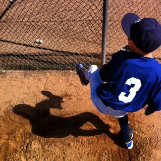 Joe Proudman  / Tahoe Daily Tribune. Jaxon Kennedy, 10, of the Yankees, warms up before facing the Dodgers on Saturday morning at Fred Rightmier Field.