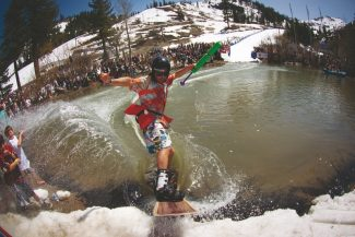 Courtesy of Jeff EngerbretsonTruckee snowboarder Jeremy Jones sprays some young viewers during the Cushing Crossing at Squaw Valley on Sunday. Jones received $100 for winning the men's snowboard category.