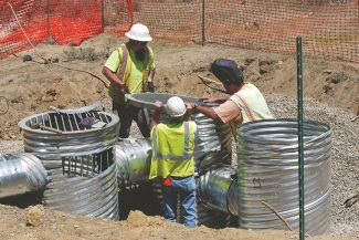 Susanne Haala / Tahoe Daily TribuneConstruction workers install the new drainage system next to the bike path section at Sawmill Road Wednesday.
