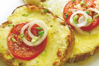 Open sandwiches with grilled cheese, tomato and onion.  A delicious melting snack.