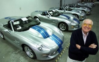FILE - In this Friday, Oct. 27, 2000 file photo, automotive legend Carroll Shelby poses in front of his Shelby Series 1 sports cars at his plant in Las Vegas, NV.  Shelby was as known for his achievements in the world of auto racing as he was on the competitive chili circuit, even founding the International Chili Society.(AP Photo/K.M. Cannon, File)