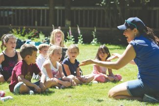 """Susanne Haala / Tahoe Daily TribuneActing instructor Kira Galindo teaches songs to children who will play the Winkies for """"The Wizard of Oz"""" production Tuesday at the lawn of Tallac Historic Site."""