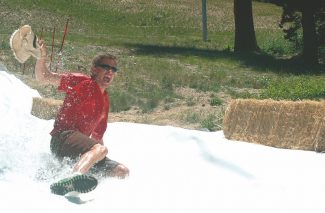 Axie Navas/Tahoe Daily TribuneSean Sweeney, one of the partners of the Sierra Recon event, tested out the giant slip and slide on Wednesday.