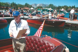 Axie Navas / Tahoe Daily TribuneDon Curtis judges a boat on Friday at the South Tahoe Wooden Boat Classic in the Tahoe Keys Marina.
