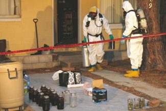 Provided to the TribuneAuthorities remove items from a suspected DMT laboratory on Tata Lane this week.