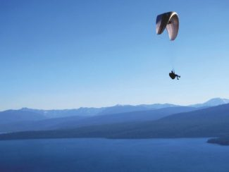 "Dylan Silver / Tahoe Daily TribuneA paraglider flies over the ""Best Lake in America"" in this Tribune file photo."