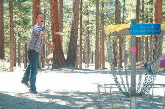 Axie Navas / Tahoe Daily TribuneRyan Bestelmeyer aims for a basket at the Bijou disc golf course on Wednesday. Bestelmeyer and his church group from Long Beach, Calif. have come up to the Tahoe course every summer for the last eight years.