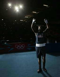 United States' Claressa Shields reacts following a fight against Kazakhstan's Marina Volnova in a women's middleweight 75-kg semifinal boxing match at the 2012 Summer Olympics, Wednesday, Aug. 8, 2012, in London. (AP Photo/Ivan Sekretarev)