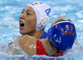 Liu Ping of China, right, moves her head back as Federica Radicchi of Italy reacts to contact during their women's semifinal fifth to eighth place water polo match at the 2012 Summer Olympics, Tuesday, Aug. 7, 2012, in London. (AP Photo/Alastair Grant)