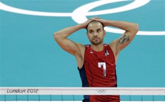 USA's Donald Suxho (7) reacts as Italy scores a point during a men's volleyball quarterfinal match at the 2012 Summer Olympics Wednesday, Aug. 8, 2012, in London. (AP Photo/Chris O'Meara)