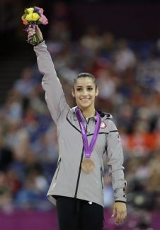 Bronze medallist for the balance beam Alexandra Raisman from the U.S. celebrates during the artistic gymnastics women's apparatus finals at the 2012 Summer Olympics, Tuesday, Aug. 7, 2012, in London. (AP Photo/Gregory Bull)