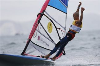 Dorian Van Rijsselberge celebrates after winning the rs:x men gold medal at the London 2012 Summer Olympics, Tuesday, Aug. 7, 2012, in Weymouth and Portland, England. (AP Photo/Bernat Armangue)