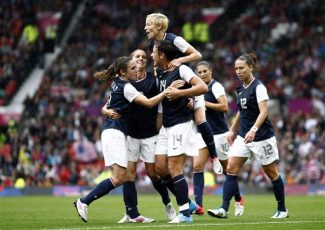 United States' Abby Wambach, bottom center, celebrates with teammates including Megan Rapinoe, top, after scoring against North Korea during their group G women's soccer match at the London 2012 Summer Olympics, Tuesday, July 31, 2012 at Old Trafford Stadium in Manchester, England. (AP Photo/Jon Super)