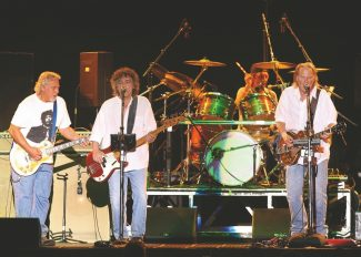 """Jim Grant / Harrah's HarveysCrazy Horse, from left, Frank """"Poncho"""" Stampedro, Billy Talbot, Ralph Molina and Neil Young, shake South Shore on Aug. 9."""
