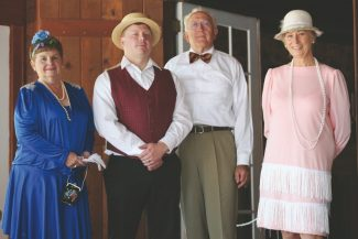 Susanne Haala / Tahoe Daily TribuneLynne Sommerfeld, from left, playing Ms. Lillian; David Ayers, playing one of the staff members; John Shilling, playing George Pope Sr.; and Carolyn Grubb, playing Claire Heller, are shown before giving a tour at the Pope Estate Sunday during the Great Gatsby Festival.