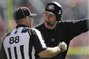 San Francisco 49ers head coach Jim Harbaugh, right, argues with an official during the second quarter of an NFL preseason football game against the Denver Broncos in Denver, Sunday, Aug. 26, 2012. (AP Photo/Joe Mahoney)