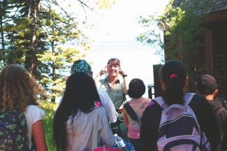 Provided to the TribuneTallac Historic Site Forest Service employee Tami Africa teaches fourth-graders about Tahoe's founding families at the Tallac Historic Site boathouse for the Children's Forest.  Students view the historic structures and learn about the modes of transportation in Lake Tahoe during the late 1800s and early 1900s.
