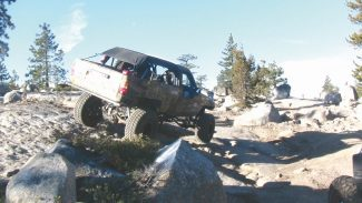 Ken Hower / Provided to the TribuneA four-wheel drive vehicle makes its way over some of the large boulders that have the Rubicon Trail famous.