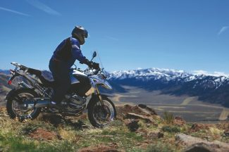 adventuremotorcyclerendezvous.comMotorcyclist Mark White looks at the Sierra Nevada from Monitor Pass during a ride in May.