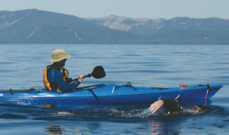 Courtesy of Brian Hayes Patterson Jamie Patrick swims beside his kayaking crewmember in 2010 when he completed a double-crossing of Lake Tahoe totaling 44 miles. Patrick embarks on a 40-hour, 68-mile long swim along the lake's perimeter today.