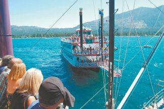 Lake Tahoe Cruises Passengers aboard the Tahoe Queen look at the trailing M.S. Dixie II during the annual paddleboat race. The M.S. Dixie II leads the series, 11-8. Saturday's race starts at 10:30 a.m.