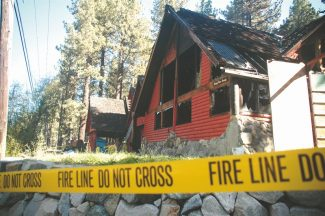 Axie Navas / Tahoe Daily TribuneWednesday morning saw fire crews continuing the investigation of the cause and origin of a Tuesday night fire that destroyed two homes at the corner of Pioneer Trail and April Drive.