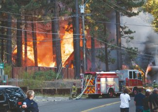 Ethan Prouhet / Submitted to the TribuneA house on April Drive is shown engulfed in flames Tuesday evening.