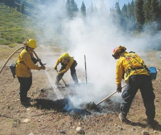 Provided by Integrated Environmental Restoration SFirefighters test fire risk of materials during a three-year study of defensible space and erosion control.