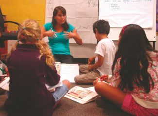 Axie Navas / Tahoe Daily TribuneAdriana Acebal teaches her third-grade Two Way Language Immersion students the story of Mulan in Spanish on Tuesday at the Bijou Community School.