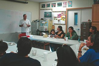 Axie Navas / Tahoe Daily TribuneNicolas Huerta counsels a group of mothers at the South Lake Tahoe Family Resource Center.