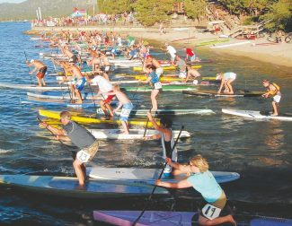 Tahoe Daily Tribune fileStand-up paddlers packed the starting line in August for the grand finale of the weekly Wednesday night SUP Race Series. This Sunday's 22-mile Fall Classic marks the final race in the O'Neill Tahoe Cup Race Series and the end of the summer paddleboarding season, according to event organizer Phil Segal.