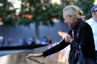 AP Photo/The Daily News, Todd MaiselAlicia Watkins remembers a friend who died at the Pentagon during a ceremony marking the 11th anniversary of the Sept. 11 attacks at the National September 11 Memorial at the World Trade Center site in New York, Tuesday, Sept. 11, 2012.