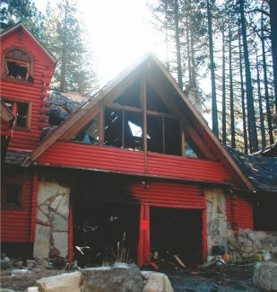 Axie Navas / Tahoe Daily Tribune fileE. Peter Darvas' house at 3120 Pioneer Trail is shown the day after the Sept. 18 fire that was started by an antique wood-burning stove in his studio and gutted the building.