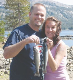 Courtesy of Doug Busey Jon and Jenifer Neilson from South Lake Tahoe rented a boat a couple weeks ago and caught a nice dinner of rainbows in the middle of Caples Lake. They were using green power bait and worms. -