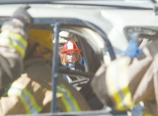 Dan Thrift / Tahoe Daily Tribune fileJacob Hailey, 7, watches as members of Lake Valley Fire Protection District remove the roof of a car during an extrication demonstration at the 2007 FireFest at the Lake Tahoe Airport.