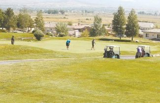 Shannon Litz / R-C file photoGolfers putt at Genoa Lakes Golf Resort on Wednesday.