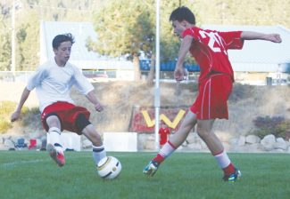 Becky Regan / Tahoe Daily TribuneCharles Jurzenski puts the block on a Quincy defender in Whittell's game Monday. The boys defeated Quincy 8-0 with six goals in the first half. They now sit 12-1-0 overall.