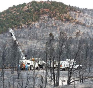 Kurt Hildebrand / The Record-CourierNV Energy linemen work to restore power near Double Spring Summit in the Pine Nuts.