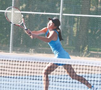 Becky Regan / Tahoe Daily Tribune South Tahoe's No. 1 singles player Maggie Lee comes into the net to put away the point in the Viking's 11-7 win against Carson Tuesday.