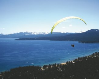 Honza Rejmanek / Provided to the TribuneNate Scales, an American paraglider who has competed in the Red Bull-X Alps race, flies above Lake Tahoe near Kings Beach.