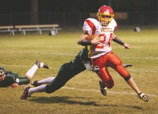 Sylas Wright / Special to the Tribune Garrett Bronken leaves Incline in his dust as he plows down the field in the Warriors' away game Friday.